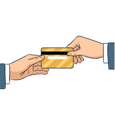 Hand give bank card pop art vector