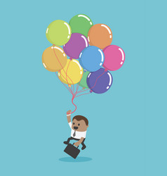 a black businessman flying with balloons business vector image