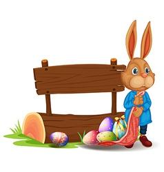 A bunny near a wooden signboard with eggs vector image vector image