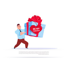 Man holding big gift box with heart shape label be vector