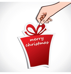 merry christmas gift in hand vector image