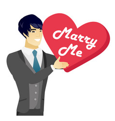 Young asian man making a marriage proposal vector