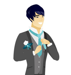 young asian cheerful groom adjusting tie vector image vector image