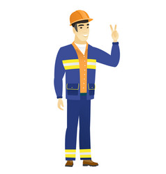 asian builder showing the victory gesture vector image