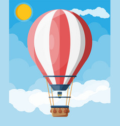 Hot air balloon in sky with clouds and sun vector