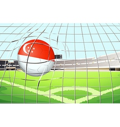 A soccer ball with the flag of Singapore hitting a vector