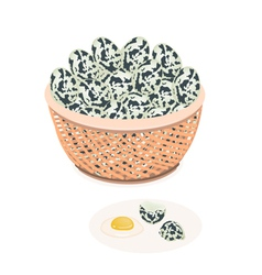 An Fresh Quail Eggs in Brown Basket vector image
