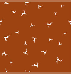 silhouettes of deer on brown background seamless vector image