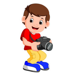 little boy cartoon holding camera vector image