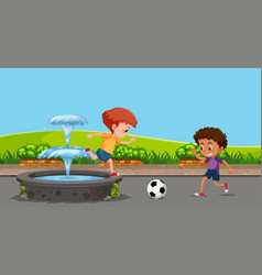 boy playing football at the garden vector image