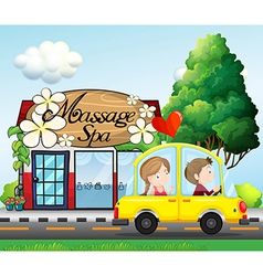 A couple riding in a car near the massage spa vector image vector image