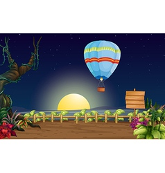 A hot air balloon in a bright full moon vector image