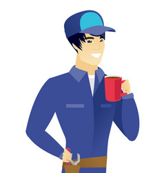 Young asian mechanic holding cup of coffee vector