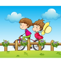 A couple riding a bicycle vector image