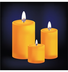 Realistic three yellow candles on dark background vector image