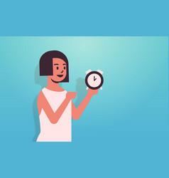 Woman holding clock time management deadline vector