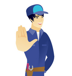 Young asian mechanic showing palm hand vector