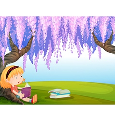 A girl reading a book at the park vector
