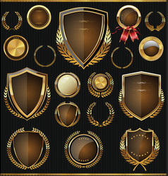 Golden shields labels and laurels collection vector