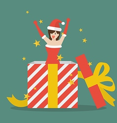 Santa girl out of big gift box vector image vector image