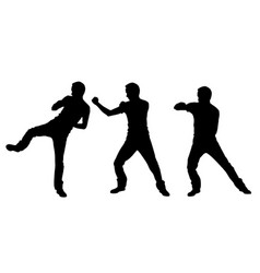 silhouettes of fighting men vector image