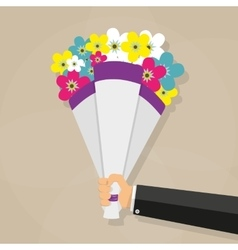 Businessman hand holding bouquet vector image