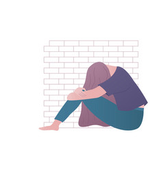 Depressed or upset girl sitting brick wall vector