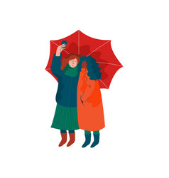 two girls dressed in seasonal clothes walking vector image