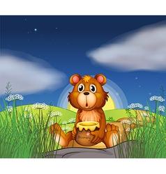 A bear at the hilltop holding a pot of honey vector