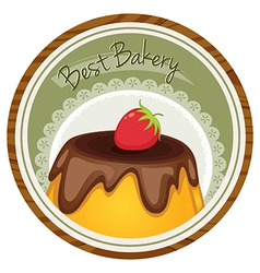 A best bakery label with a cake and a strawberry vector