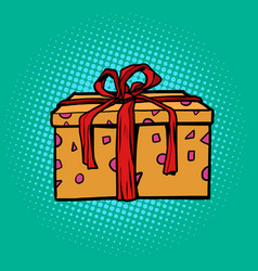 gift box with a red ribbon on a pop art background vector image