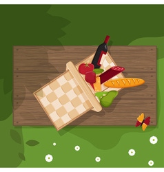 picnic basket on wooden background vector image