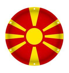 Round metallic flag of macedonia with screw holes vector
