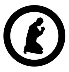 Man pray on his knees silhouette icon black color vector