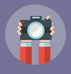 Hands holding camera vector image