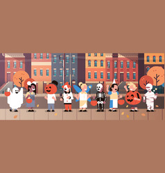 kids wearing monsters costumes walking town home vector image