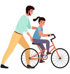 Caring dad teaching daughter to ride bike vector