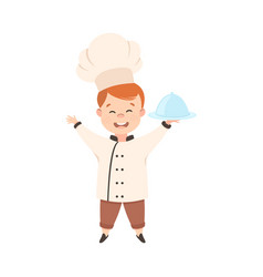 Cute boy chef cook holding round cloche tray vector