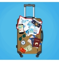 Tourist equipment on brown travel suitcase bag vector image