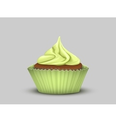 Delicious cupcake with green cream vector image