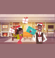African american couple in santa hats holding vector