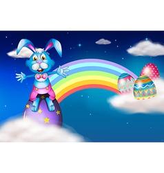 An easter bunny and eggs near the rainbow vector image