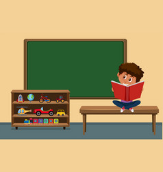 boy reading book in the classroom vector image
