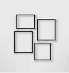 Empty black frames on a white wall template vector