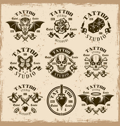 Tattoo studio emblems in vintage style vector