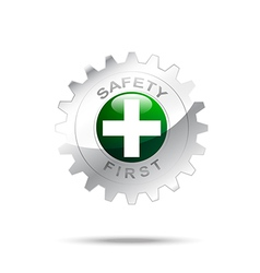 Safety first symbol on gear icon vector image