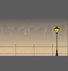 Silhouette of town with street lamp scenery vector