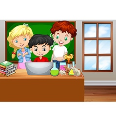 Children looking at computer in classroom vector image vector image