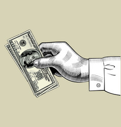 Hand of man holding 100 dollars bank notes vector