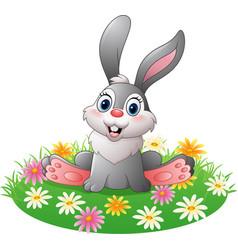 cartoon rabbit sitting on the grass vector image